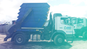 m60 skip hire truck carrying five skips side view