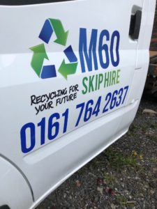 m60 skip hire logo on truck door of a van