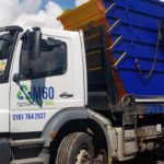 m60skiphire truck carrying five blue-yellow skips