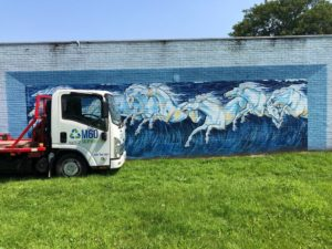 m60 skip hire truck and horse painted wall