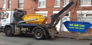 truck pulling a skip