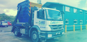 m60 skip hire truck carrying five skips semi front view