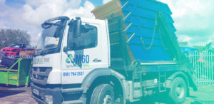 m60 skip hire truck carrying five skips