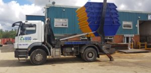 a truck carrying five skips load