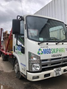m60 skip hire truck side angle view