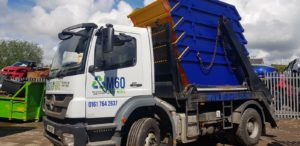 m60 skip hire truck carrying five blue-yellow skips