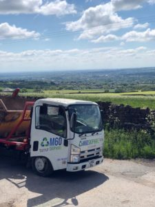 m60 skip hire truck at the road