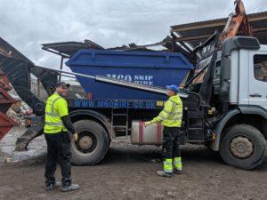 m60 skip hire blue on a truck
